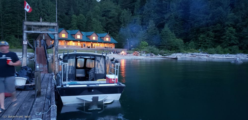 Quintessential Off-Grid Canadian Lakefront Retreat with Stunning Mountain Views and Secluded Beach